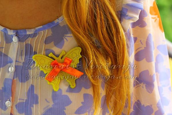 Žuti leptir sa narandžastom trakom, jedan je od favorita.